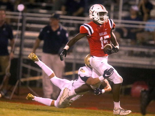 Oakland's Jeron Rooks (15) makes a catch and is tackled
