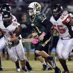 Palm Bay's Chase Harris comes up with a pass despite suffocating defense by Viera's Jay Boyd (25) and Evan Cruz (20) during Friday's game.