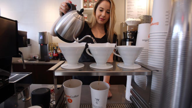 Manager Olivia DeMattio makes a pour over micro batch of Simple Coffee's Bali organic blend.