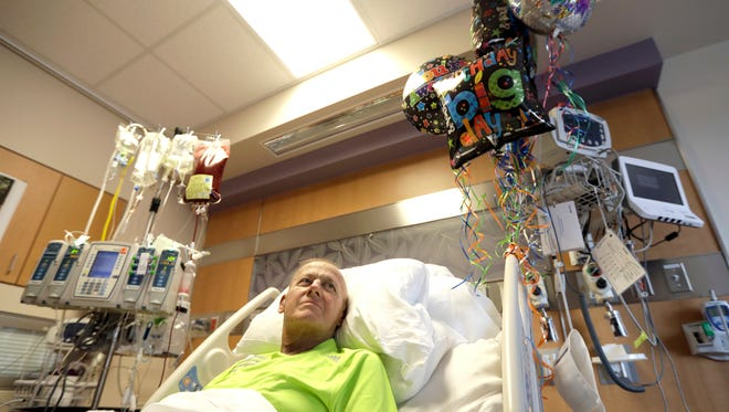 Sportscaster Craig Sager lies in his bed while receiving a transplant Wednesday, Aug. 31, 2016, at MD Anderson Hospital in Houston. Sager underwent his third bone marrow transplant as he continues to battle Acute myeloid leukemia.