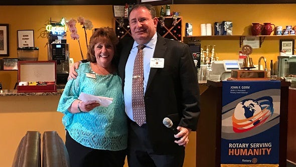 Carol Fritsch, Collier County Teen Court Coordinator, receives a $1,000 donation from Sunrise Club President Neil Snyder on May 30. The donation will go toward scholarships as well as awards for the Teen Court participants.