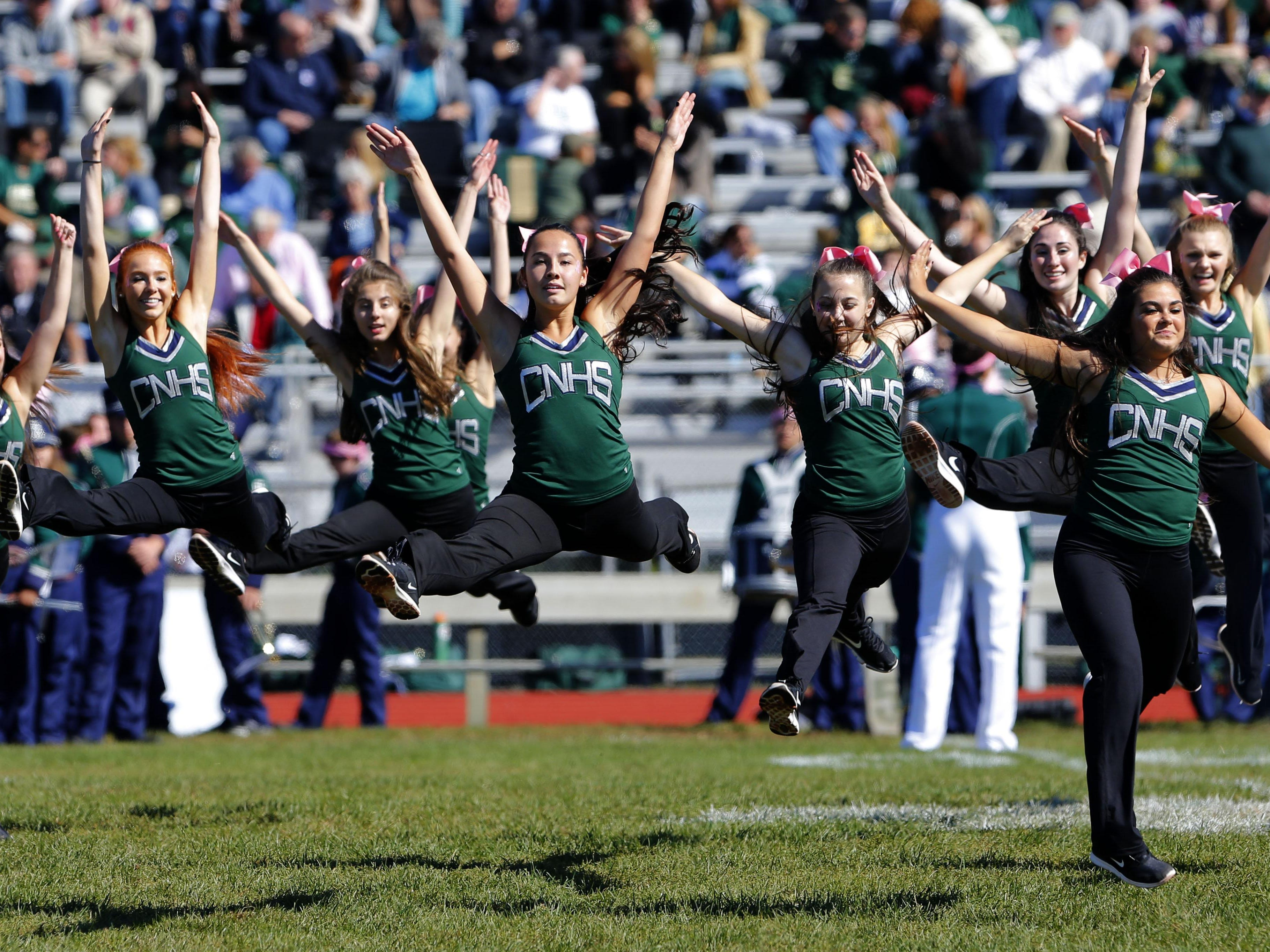Members of the Colts Neck dance team perform during half time at Colts Neck High School, Colts Neck,NJ. Saturday, October 10, 2015.
