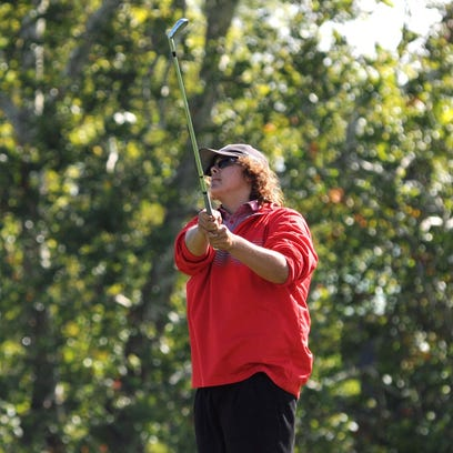 Piketon's D.J. Graham tees off on the 12th hole during