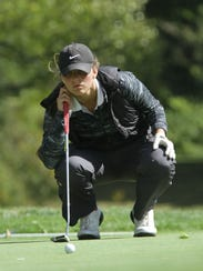 Shelby's Claire Korbas lines up a putt during Tuesday's