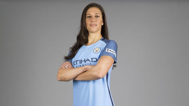 Manchester City's new signing for their women's team Carli Lloyd from the US poses in her new kit in Manchester, England.