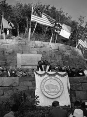 President Franklin D. Roosevelt dedicates the Great Smoky Mountains National Park at Newfound Gap on September 2, 1940. Secretary of the Interior Harold Ickes is seated just to the right of the microphones. Next to him at the right Eleanor Roosevelt. At extreme right Gov. Clyde Hoey of North Carolina. Also pictured are U.S. Sen. Robert Reynolds of North Carolina and U.S. Sen. Kenneth McKellar of Tennessee. (AP Photo)