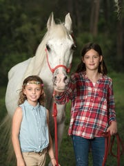 Sisters Bella and Angelina Hively with Designer the horse.