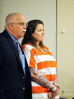 Tami Huntsman with defense lawyer Scott Erdbacher at Monterey County Superior Court in Salinas on Wednesday.