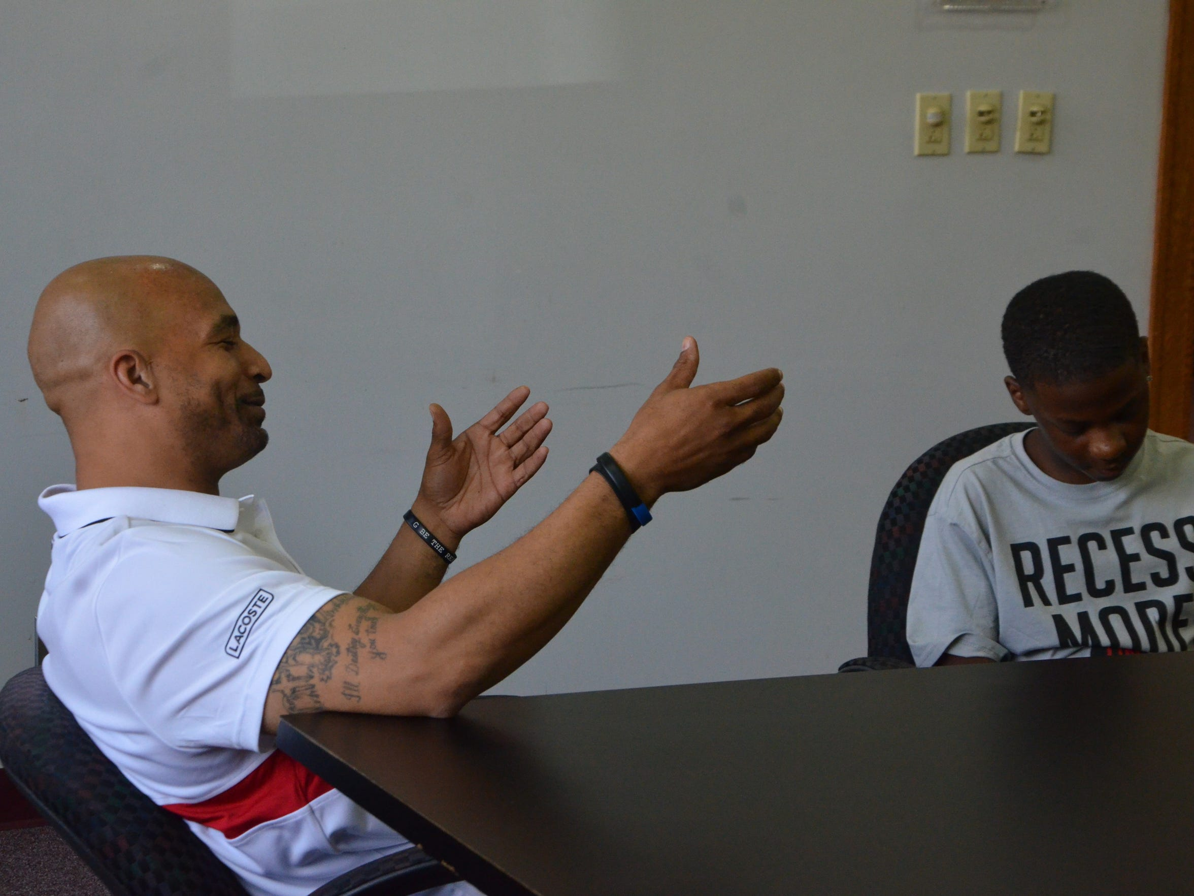 Damon Brown talks with Nasir Robertson during a mentoring