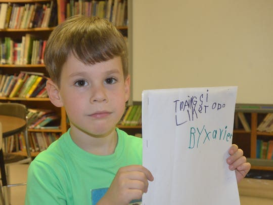 "Five-year-old Xavier Bonney wrote the book, ""Things I like to do,"" last week."