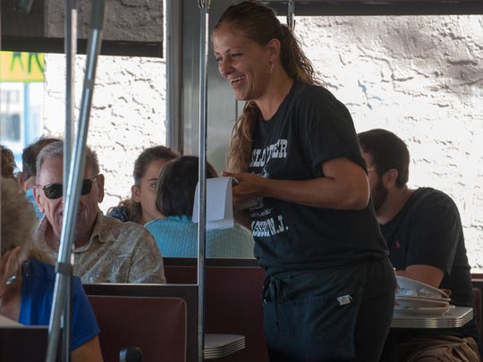 Angelo's Diner's waitress, Dawn Siciliano, smiles with costumers at the Angelos Diner in Glassboro. The diner received help and support from the community and other business around the town after suffering from small fire. Siciliano has work at the diner for 21 years.