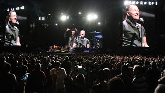 Bruce Springsteen towers over the audience as he performs with the E Street Band at MetLife Stadium in East Rutherford, NJ, Tuesday, August 23, 2016.
