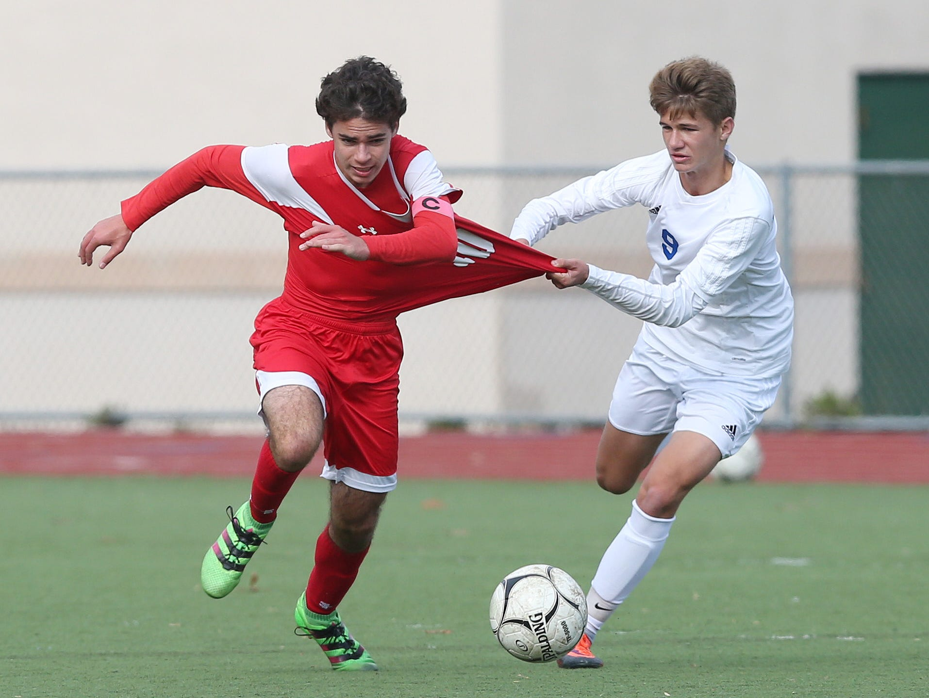 Somers Jack Maher (10) tries to break away from Pearl River's Denis Fleming (9) during the boys soccer Section 1 Class A championship game at Lakeland High School in Shrub Oak High School Oct. 29, 2016. Somers won the game 1-0.