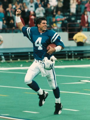(INDIANAPOLIS STAR FILE PHOTO) Indianapolis Colts QB Jim Harbaugh celebrates as he leaves the field following an 18-17 win over San Francisco at the RCA Dome on Oct. 15, 1995. (PAUL SANCYA PHOTO)
