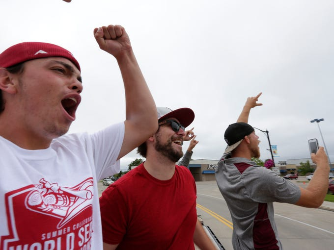 Wisconsin Rapids Rafters players cheer as fans honk