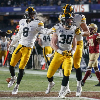 Members of the Iowa defense celebrate after junior