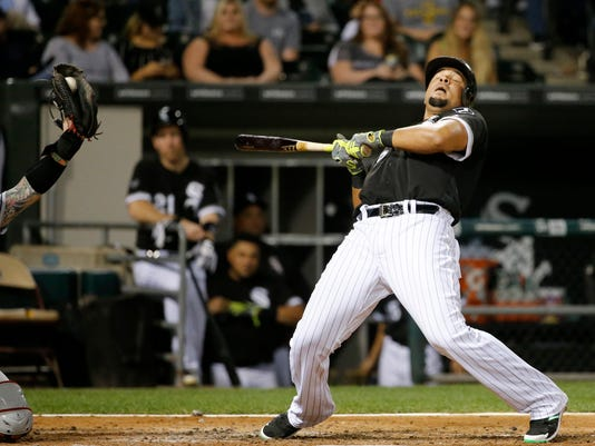 Chicago White Sox's Jose Abreu reacts to a high and inside pitch from Cleveland Indians starting pitcher Trevor Bauer during the fourth inning of a baseball game, Tuesday, Sept. 13, 2016, in Chicago. (AP Photo/Charles Rex Arbogast)