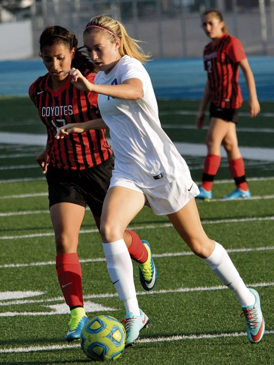 Matt Hollinshead — Current-Argus Carlsbad junior forward Lauryn Wade pulls ahead of Roswell junior Viri Campas and scores the first of her two goals late in the first half Tuesday.