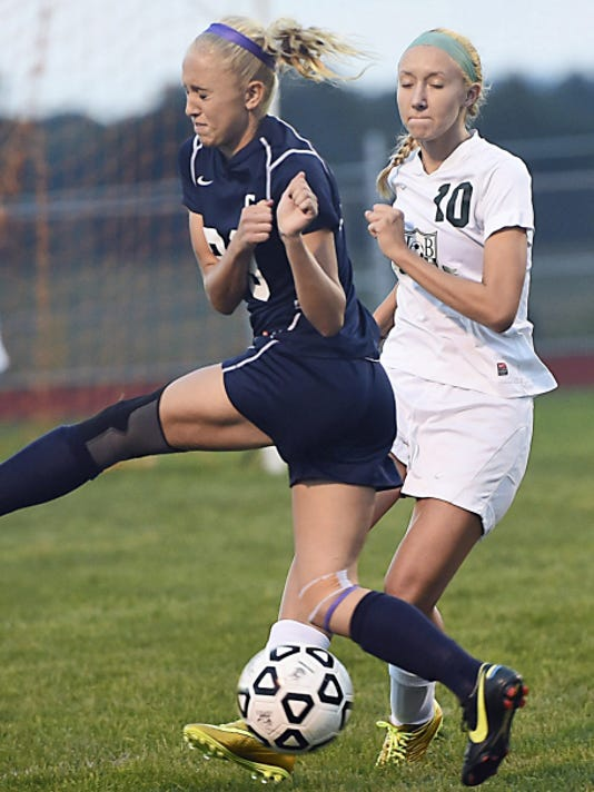 Greencastle-Antrim's Ally Rudy, left, the two-time P.O. Player of the Year, is defended by Taylor Gorman of James Buchanan during a game last September. Rudy enters the season with 62 career goals, while Gorman is expected to anchor the Rocket defense.