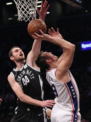 The Bucks acquired Tyler Zeller (left) to help bulk up their front line.
