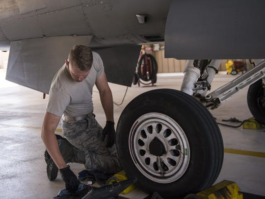 Airman 1st Class Derek King, a 54th Aircraft Maintenance Unit F-16 crew chief, performs maintenance on an F-16 Fighting Falcon at Holloman Air Force Base on May 3. The 54th AMU runs 24 hour operations. Therefore, Holloman's maintenance Airmen work round-the-clock to keep these aircraft operable and flying.