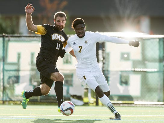 Vermont's Brian Wright (7) battles for the ball with