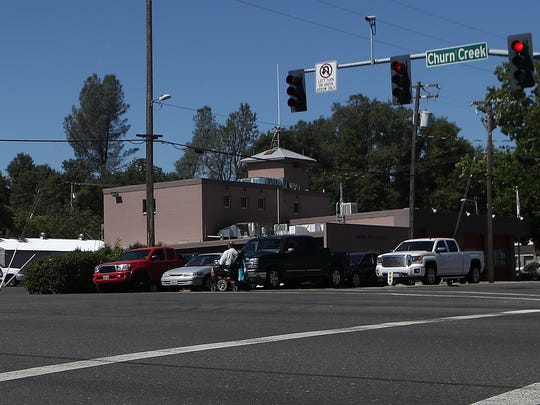 A man crosses a busy intersection at Churn Creek Road and Hartnell Avenue.
