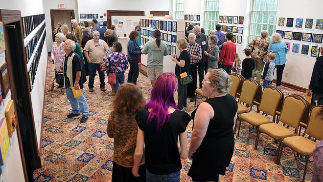 Professional and amateur artists, their friends and family turned out Thursday evening for the opening of the Mystery Art Fest exhibit at the Kemp Center for the Art. The exhibit will be open to the public through October.