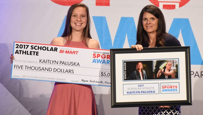 Kaitlyn Paluska poses for a picture with soccer great Mia Hamm as she accepts the Scholar Athlete award during the Statesman Journal Sports Awards on Tuesday, June 6, 2017, at the Salem Convention Center.