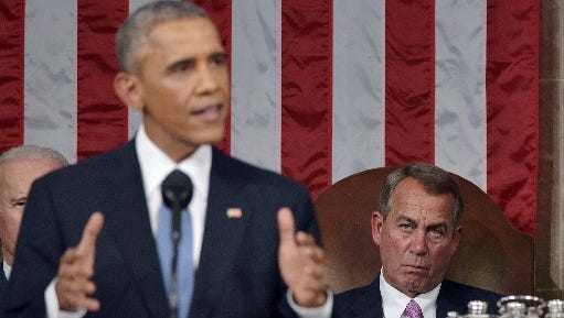 U.S. Speaker of the House John Boehner, right,  listens to President Barack Obama deliver the State of the Union address on Jan. 20, 2015, in the House Chamber of the U.S. Capitol in Washington, D.C.
