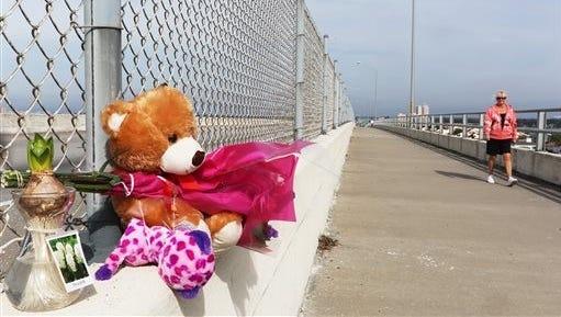 A memorial for Phoebe Jonchuck, 5,  has been set up atop the Dick Misener Bridge in St. Petersburg, Fla.