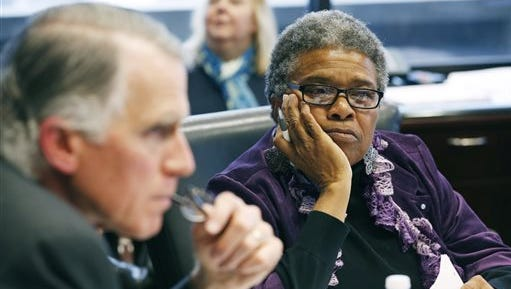 Andy Taggart and Constance Slaughter-Harvey listen as a meeting of the governor's task force studying contracts from the state Department of Corrections.