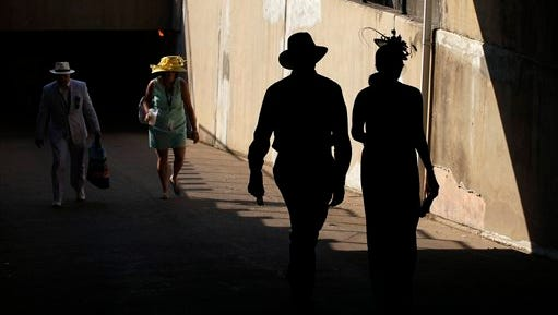 Fans arrive before the 141st running of the Kentucky Derby horse race at Churchill Downs Saturday, May 2, 2015, in Louisville, Ky. (AP Photo/Charlie Riedel)