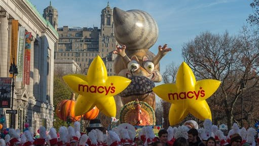 Performers stand in front of balloons at the start of the Macy's Thanksgiving Day Parade Thursday in New York.