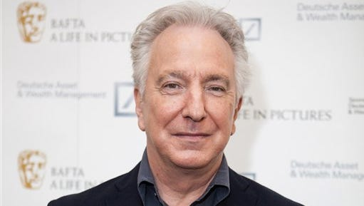 """FILE - In this Wednesday, April 15, 2015 file photo, actor Alan Rickman poses for photographers on arrival at 'BAFTA A Life In Pictures, with Alan Rickman'  in central London.  British actor Alan Rickman, whose career ranged from Britain's Royal Shakespeare Company to the """"Harry Potter"""" films, has died. He was 69.  Rickman's family said Thursday, Jan. 14, 2016 that the actor had died after a battle with cancer. (Photo by Grant Pollard/Invision/AP, File)"""