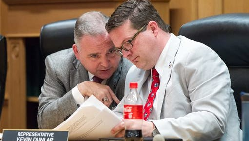 State Reps. Kevin Dunlap, D-McMinnville, and Kevin Brooks, R-Cleveland, confer during a House Education Administration and Planning Committee meeting in Nashville on Wednesday, April 6, 2016. Dunlap and Brooks were among the majority of the committee that voted to revive a bill seeking to require students to use bathrooms that match their sex at birth.