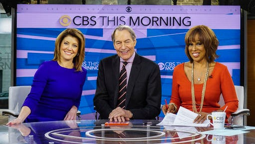 """This Dec. 7, 2016 image released by CBS shows, from left, Norah O'Donnell, Charlie Rose and Gayle King on the set of """"CBS This Morning,"""" in New York."""