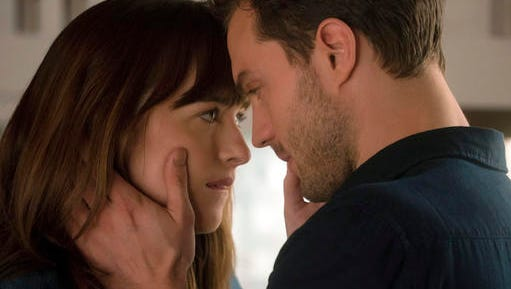 """This image released by Universal Pictures shows Dakota Johnson as Anastasia Steele, left, and Jamie Dornan as Christian Grey in """"Fifty Shades Darker."""""""