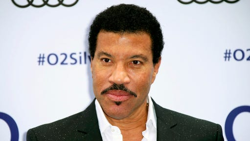 FILE - This July 1, 2016 file photo shows Lionel Richie at the Silver Clef Awards in London. Richie says he won't recover from a knee procedure in time to launch his tour with Mariah Carey next month. The 67-year-old singer said in a statement Friday, Feb. 24, 2017, that their All The Hits Tour will be postponed until the summer. The 35-date trek was supposed to launch March 15 and wrap on May 27.