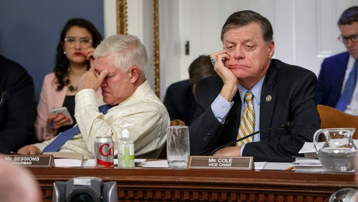After eight hours of debate, House Rules Committee Chairman Rep. Pete Sessions, R-Texas, left, and Rep. Tom Cole, R-Okla., the vice-chair, listen to arguments from committee chairs as the panel meets to shape the final version of the Republican health care bill before it goes to the floor for debate and a vote, Wednesday, March 22, 2017, on Capitol Hill in Washington.
