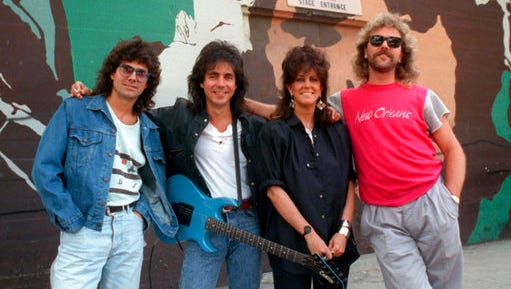 """FILE - In this July 24, 1987 file photo, members of Starship, from left, Mickey Thomas, Craig Chaquico, Grace Slick and Donny Baldwin, pose outside the Berkeley Community Theater stage entrance after a rehearsal in Berkeley, Calif. Chaquico is asking a judge to prevent a new iteration of Jefferson Starship from using the name in a federal lawsuit filed Thursday, April 27, 2017, in San Francisco. The suit states the band's members agreed to retire the Jefferson Starship name in 1985 after founding member Paul Kantner left the group. Some members later formed a group Starship, which recorded the hit """"We Built This City."""""""