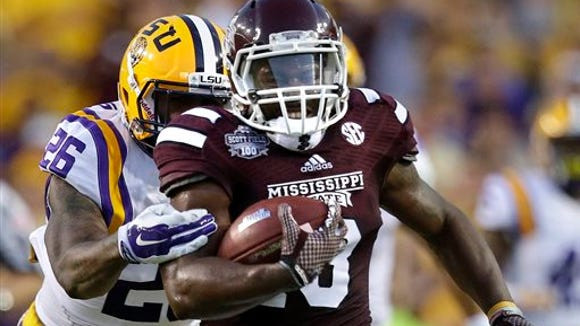 Josh Robinson (13)  and top-ranked Mississippi State still have to play at No. 3 Alabama and No. 7 Ole Miss.
