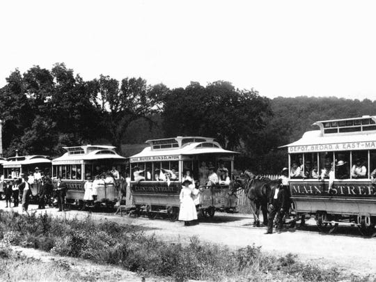 Horse-drawn trolley cars from Lancaster and other communities disembark passengers at the Fairfield County Fairgrounds in the early 1890s.