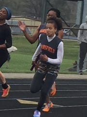 Makenna Hawk takes the baton from Alaya Grose on the third leg of Mansfield Senior's victorious 4x100 meter relay team in Thursday's Lexington Invitational.