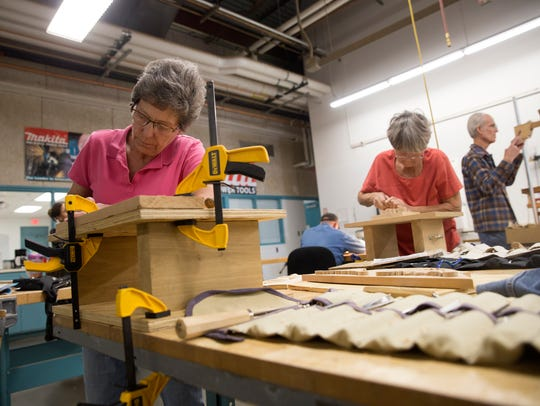 San Juan College Encore woodworking students Nancy Wray, left, Sybille Murphy and Encore woodworking instructor Wendel Petersen work on their projects Wednesday at San Juan College in Farmington.