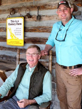 This file photo from March 29, 2016, shows John L. Batey and Brandon Whitt on the steps of the Batey Store on the 210-year-old Batey family farm.