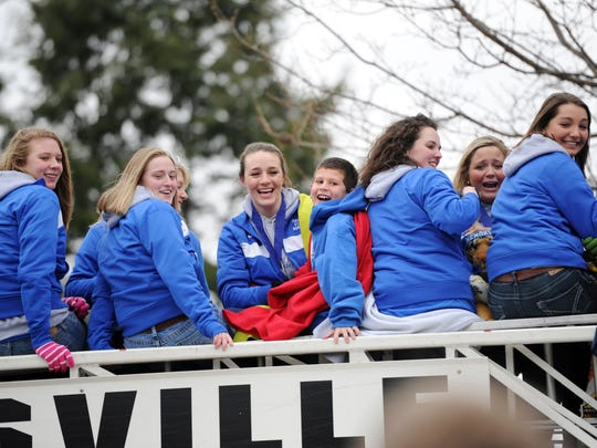 Here are the champs! The Evansville Memorial team rides a firetruck as it celebrates its 2011 Class 3A state title. The Tigers beat Benton Central 58-50 in overtime. Mallory Ladd led Memorial with 24 points and 13 rebounds.Erin McCracken/Courier & Press
