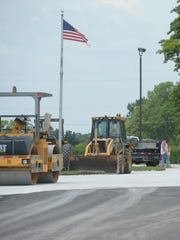 Work progresses on a new lane Wednesday in front of Northeastern Middle/High School in Fountain City.
