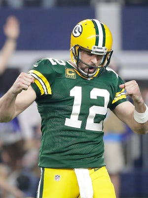 Green Bay Packers quarterback Aaron Rodgers (12) celebrates a touchdown pass against the Dallas Cowboys at AT&T Stadium in Arlington, TX Sunday, January 15, 2017.