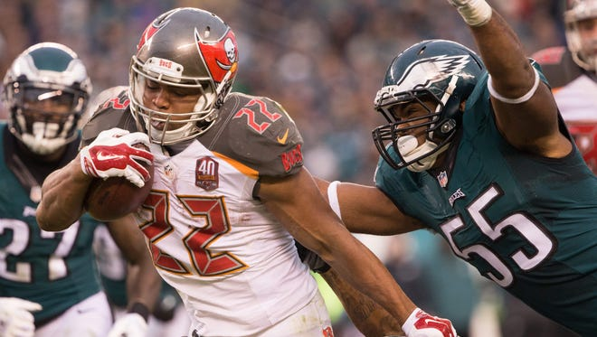 Tampa Bay Buccaneers running back Doug Martin (22) runs with the ball as Philadelphia Eagles outside linebacker Brandon Graham (55) tackles from behind.